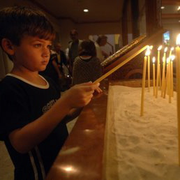Boy Lighting Candle