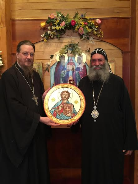 Bishop Suriel presents an icon in the Coptic tradition to Fr. John Behr.