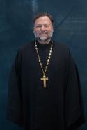 Fr Mark Doku