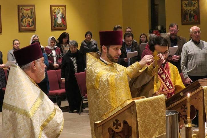 Mechanicsburg, PA: Fr. Timothy Hojnicki immerses the Cross during the Great Blessing of Waters with Fr. Nicholas Molodyko-Harris at Holy Apostles Mission.