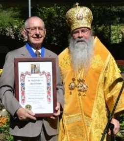 Metropolitan Tikhon awards Order of St. Romanos to Walter Shymansky in 2014.
