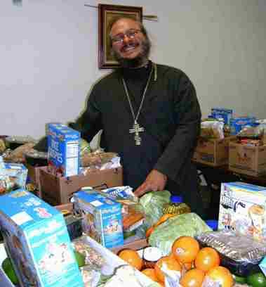 Fr. Antonio Perdomo with donations
