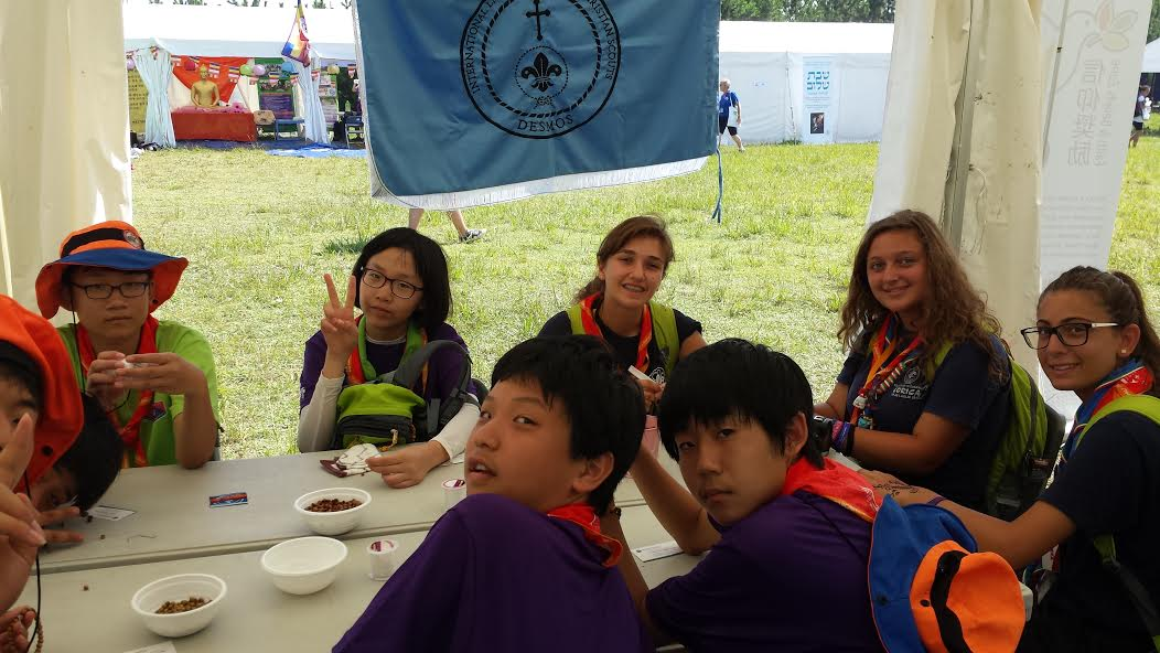 Japanese Scouts learn about Orthodox Christianity at the DESMOS booth.